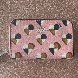 Brand new with tag Coach card case hearts